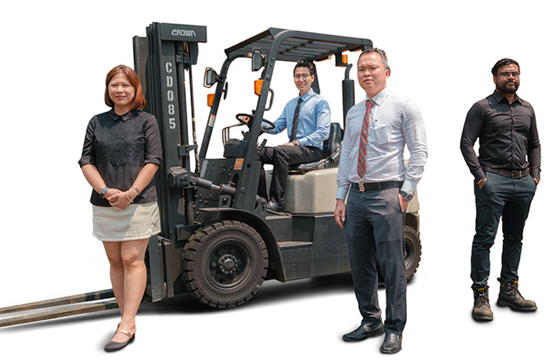 Group of Crown employees surrounding a C-5 internal combustion forklift