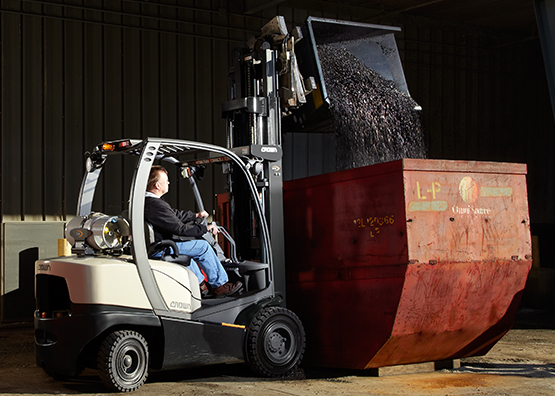 C-5 forklift in use using attachments