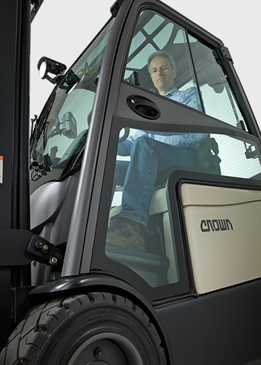 operator on Crown's SC 6000 series lift truck with hard cabin