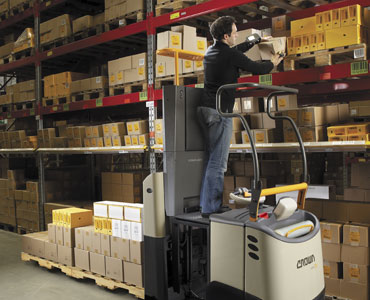 Operator using lift platform on GPC order picker forklift to reach higher