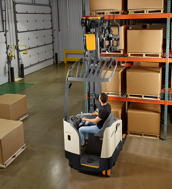 Operator utilizing the the RM/RMD sit-down reach truck increased visibility to transport loads.