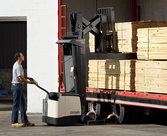 Operator maneuvers a SH/SHR Series walkie pallet reach stacker