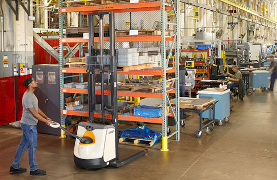 The M Series straddle stacker can be used in a pallet racking application