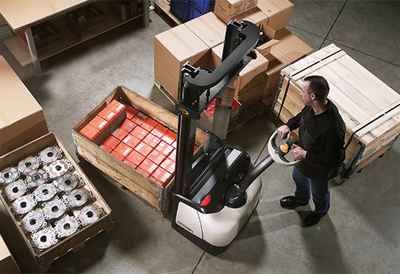 Crown's WF series fork-over pallet stacker is easily maneuvered in tight spaces