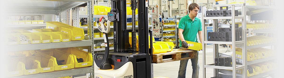 Employee utilizes QuickPick Remote Lift Technology for parts replenishment