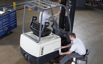 service technicians inspect remanufactured crown forklift