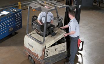 service technicians inspect used crown rider pallet truck