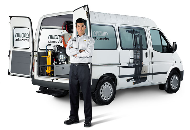 A Crown service technician with Crown service van
