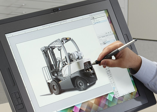 Designer works on a digital image of a Crown lift truck.